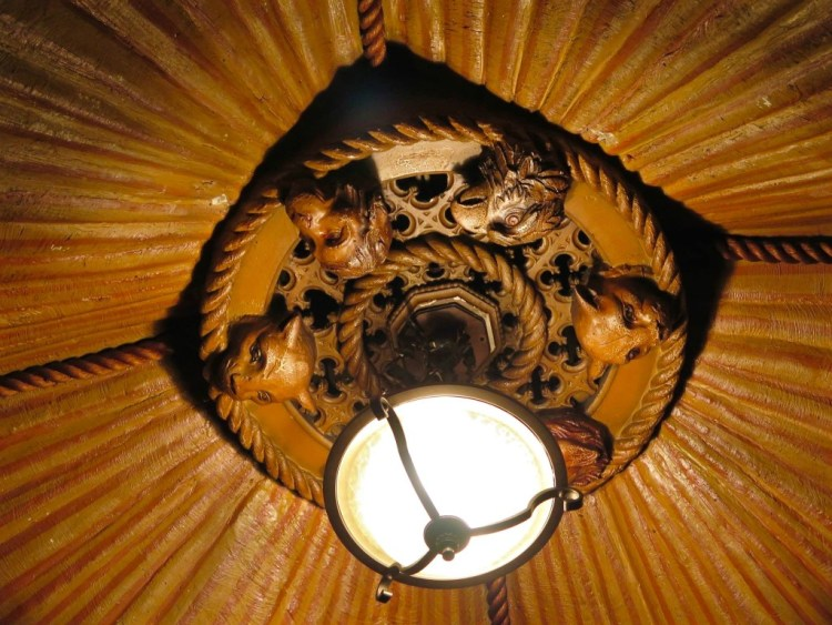 The circus-themed tent plaster ceiling, is topped off with decorative severed animal heads.