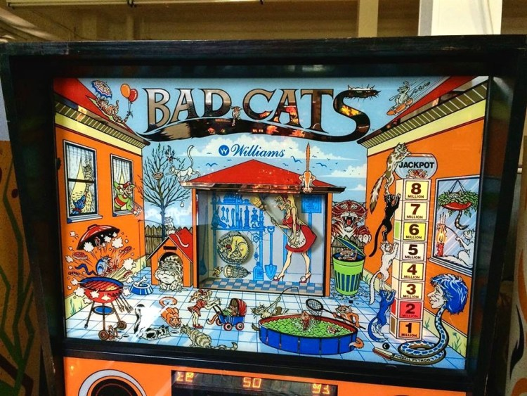 "'Bad Cats' was released in November 1989 by Williams and was designed by Barry Oursler and Python Anghelo. Anghelo said that he hated working on this game. ""Bad Cats was a joke. Bad Cats, and Bugs Bunny Birthday Ball, are one of my 'yes boy, kiss-ass'... and they're one of my worst experiences."" I like the art."