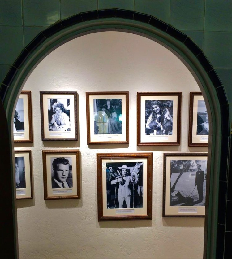 Photos of famous people that S.A. considered friends line the upstairs hallway.