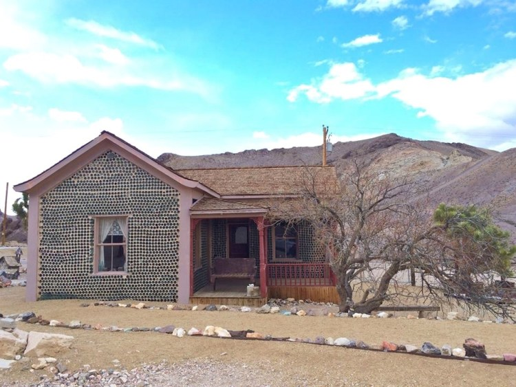 This was one of three bottle houses to be built in Rhyolite. Most of the bottles used were Adulphous Busch, (You know, it's known as Budweiser today!) He collected the bottles from the 53 saloons that surrounded the town.