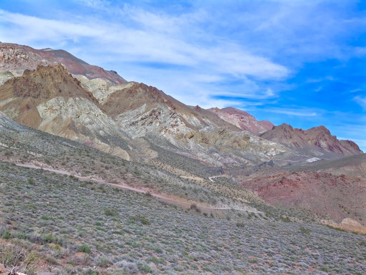 At White Pass it enters upper Titanothere Canyon. Colorful rock deposits along this section contain fossil beds 30-35 million years old. The fossil skull of a huge, rhino-like titanothere was found here in 1933.