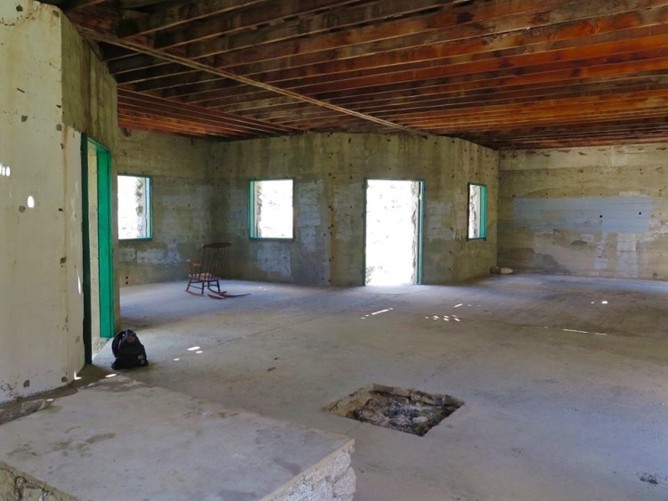 """Just south of the altar, in the concrete floor, is a thirty-two inch square hole. This spot was called """"the cornerstone,"""" and was where a person addressing the congregation was to stand."""