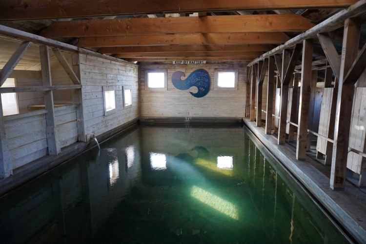 The timber frame and corrugated metal structure was built in 1928 surrounding the large hot mineral pool, providing year round comfort for soaking and healing.