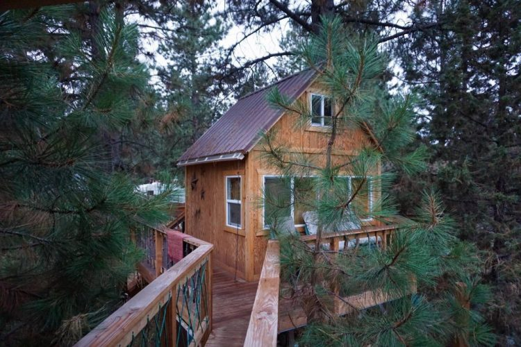 "Listed on airbnb as the ""Only Treehouse In Bend Oregon"" Adults only treehouse. 10x10 treehouse with full sized air mattress. 12x18 ""High Deck"" is attached to the treehouse by a little bridge leading to the swinging/floating queen air mattress. Fall asleep to the bubbling stream."