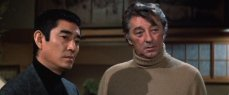 Takakura Ken and Robert Mitchum in the film directed by Sidney Pollack and written byPaul Schrader