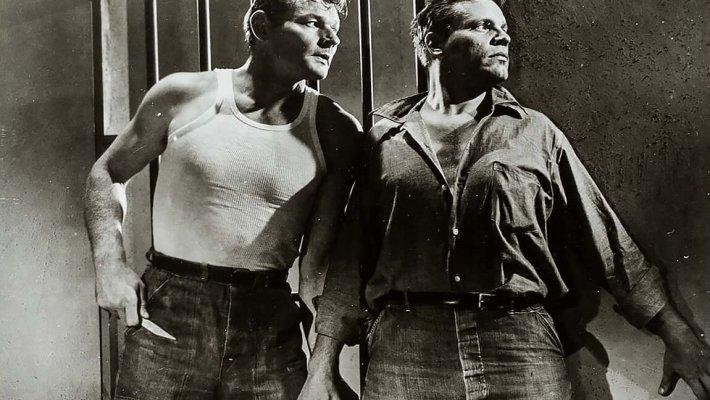Leo Gordon and Neville Brand in the prison drama by Don Siegel