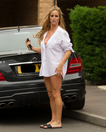 EXCLUSIVE Model and TV star of Gypsy Weddings Danielle Mason and sister of Eastenders star Jessie Wallace returns home after what looks like a night away!! wearing just a shirt and Thong as she took her case from her car , Danielle is said to have set her sights on BB star Bear! ©Exclusivepix Media