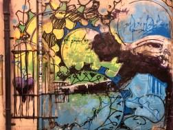 Ausschnitt aus einem Mural von El Niño de las Pinturas dass einen Mann mit einem Vogelkäfig zeigt
