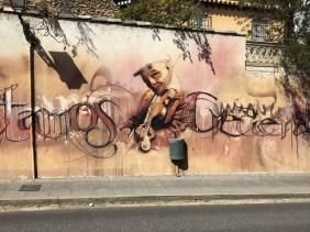 Detail eines Murals von El Niño de las Pinturas zeigt einen Geiger