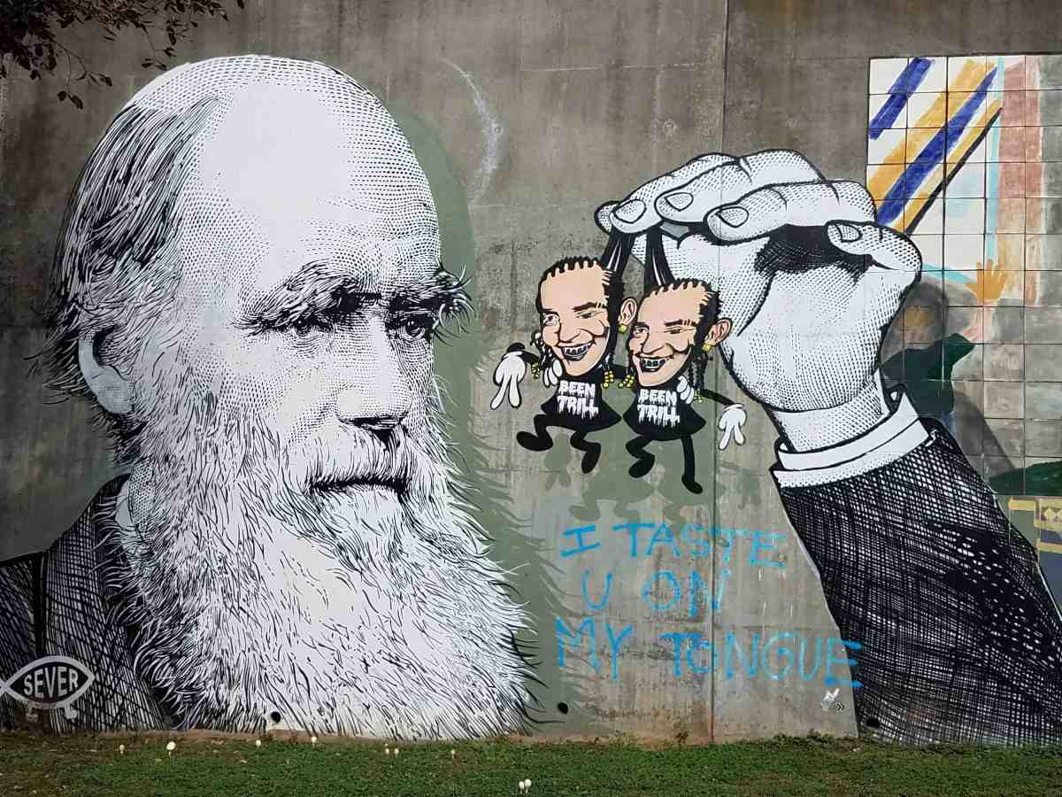 street art featuring a man with a beard holding two people by Sever