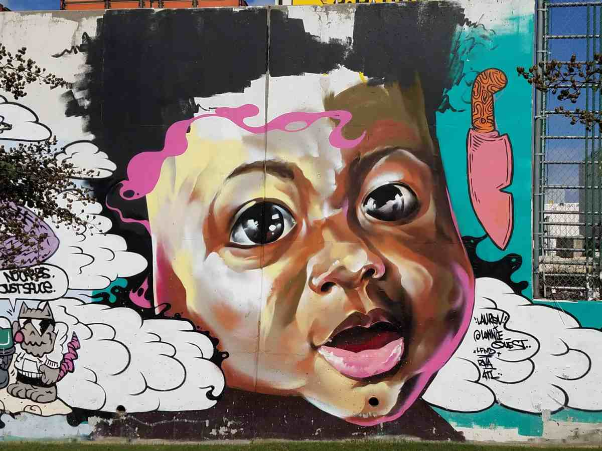 Street art by Lonnie Gardner featuring a baby's face