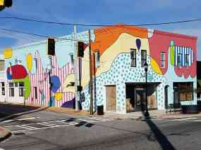 building facade painted in the blind contour drawing style by Yoyo Ferrro in College Park