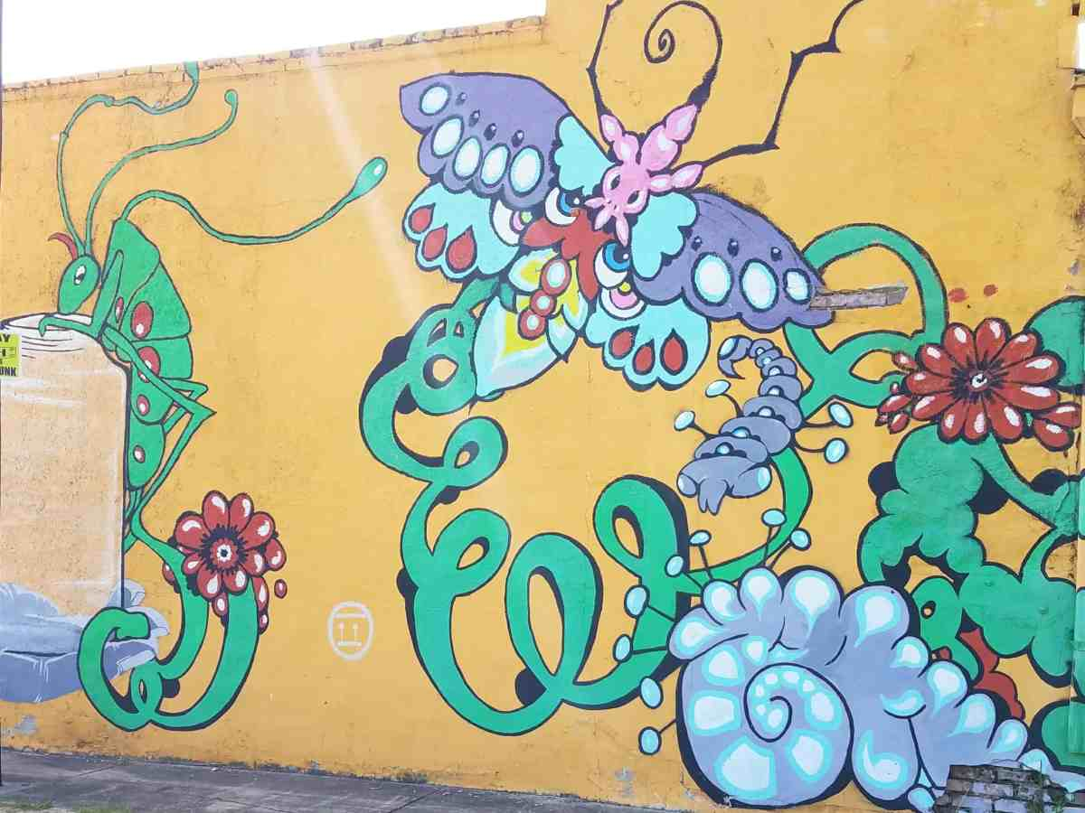 mural of plants and bugs in Grant Park Area Don't know who the artist is