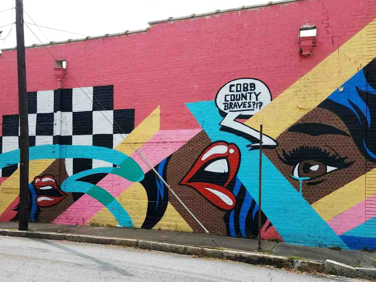 Comic style mural by artist Chris Veal in Grant Park area