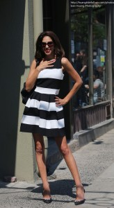 This savvy Queen West shopper is looking very chic in a black and white horizontal striped dress from Miss You (in The Netherlands) and her shiny black Jimmy Choo shoes! Wow! Photo by Ivang Huang