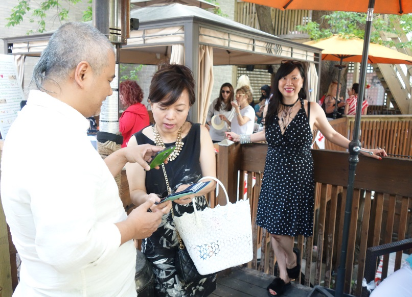 Lily Liao mingling at Jeannie Lottie's Yorkville Tree House Party