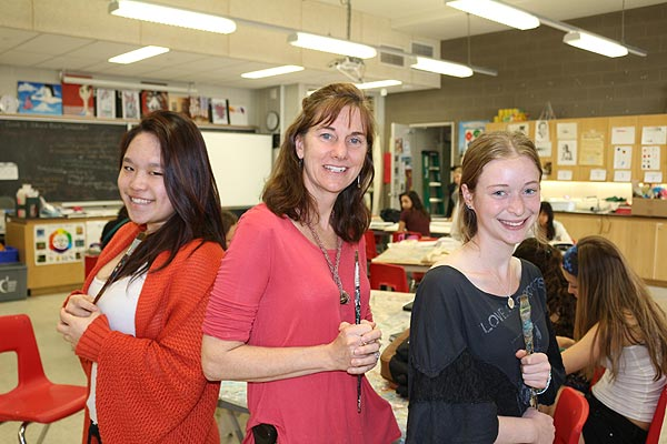 Lise Marquis, middle, is flanked by her senior visual arts students, Gisele Chen, left, and Samara Goldberg at North Toronto CI.