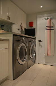 AND AFTER shot of Jennifer Flores' renovated laundry room.