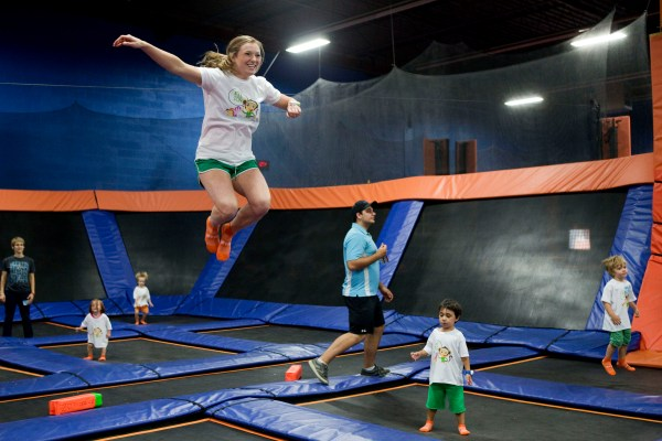 JUMP UP: Olympic gold medalist and world champion Rosie MacLennan during a trampoline session with young fans at SkyZone Trampoline Park in Leaside on Aug. 27.