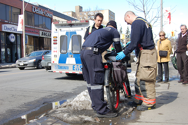 First responders locking up a bicycle