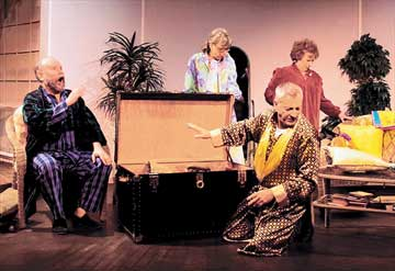 DRESS REHEARSAL: The four former opera singers look for their costumes to get ready for their comeback performance.