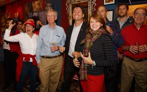 HAPPY HELPERS: Supporters at Carolyn Bennett's victory party, including local MPP Eric Hoskins (centre), cheer her accumulating vote total.