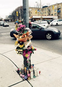 MEMORIAL to 22-year-old victim of traffic accident at Bathurst Street and Eglinton Avenue West.