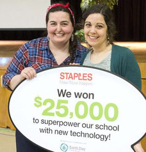 THE BIG PRIZE: Teachers Rita Filicetti, left and Lisa Gal show how much the school has won for new technology.