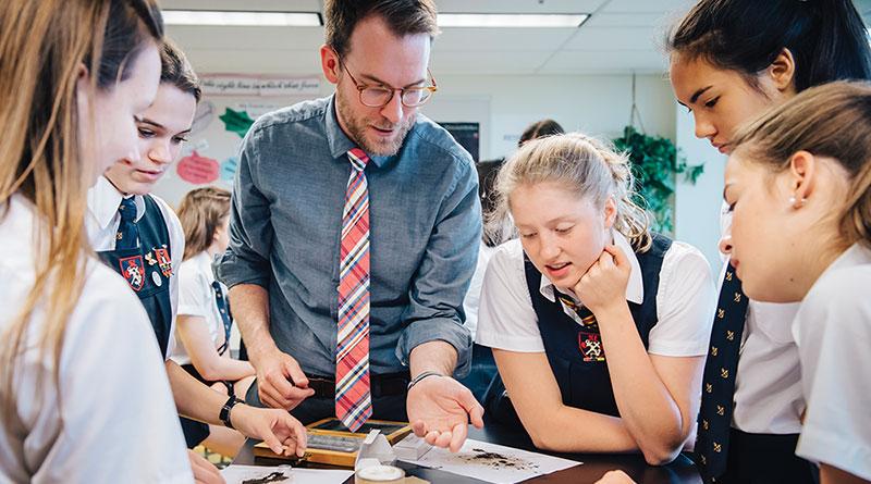 Teacher and class at all-girls school