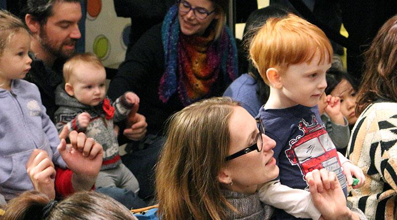 Families listen to Sharon and Bram at Indigo