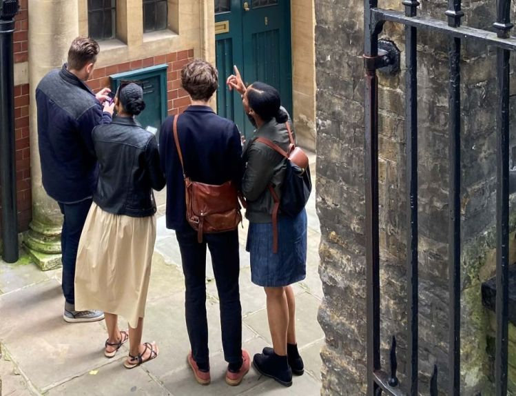 Players solving clues and visiting quirky locations in London