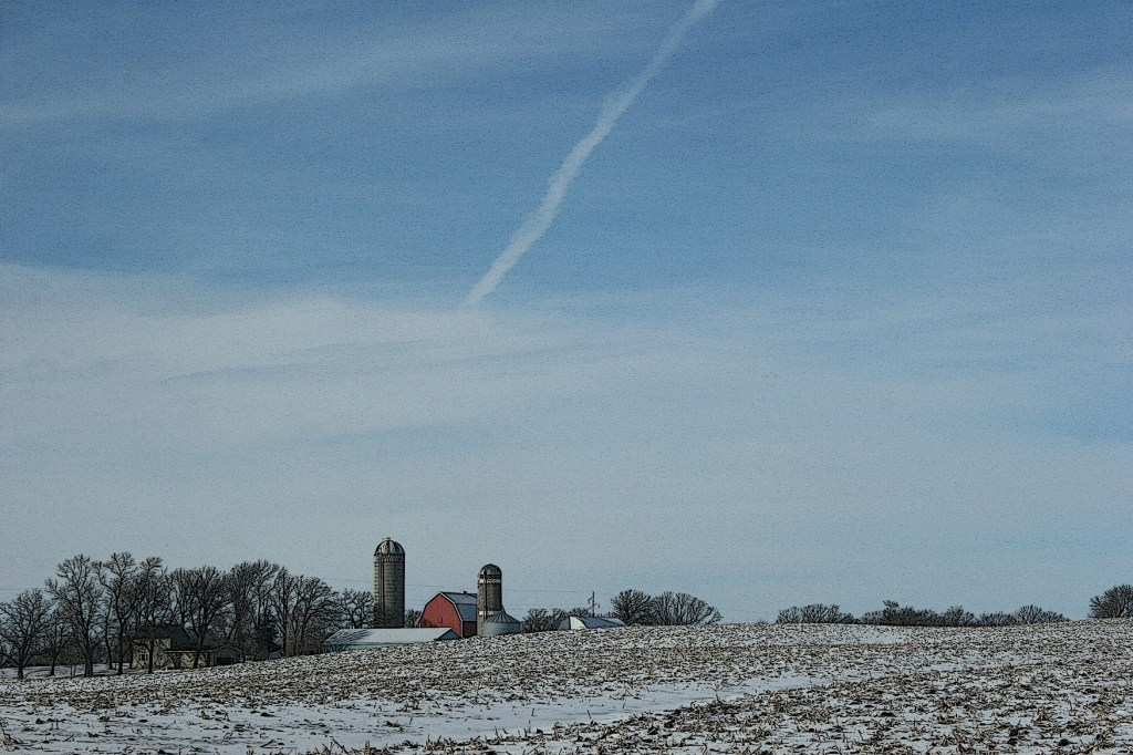 The rural scene, dominated by a blue sky, unfolds before us.