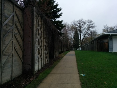 Sidewalk along the back side of the sound wall