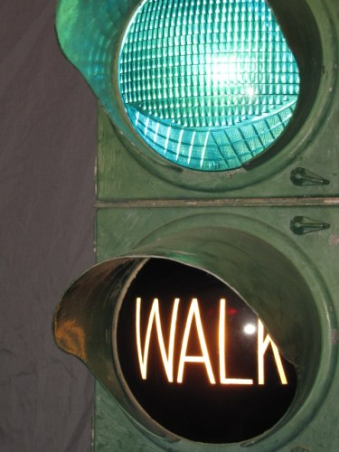 """Early pedestrian accomidations, first with the green lens designed to throw some light downward, then with the seperate """"Walk"""" lens"""