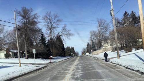 Image of man walking in street