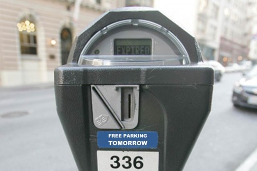 image of parking meter with free parking tomorrow sticker