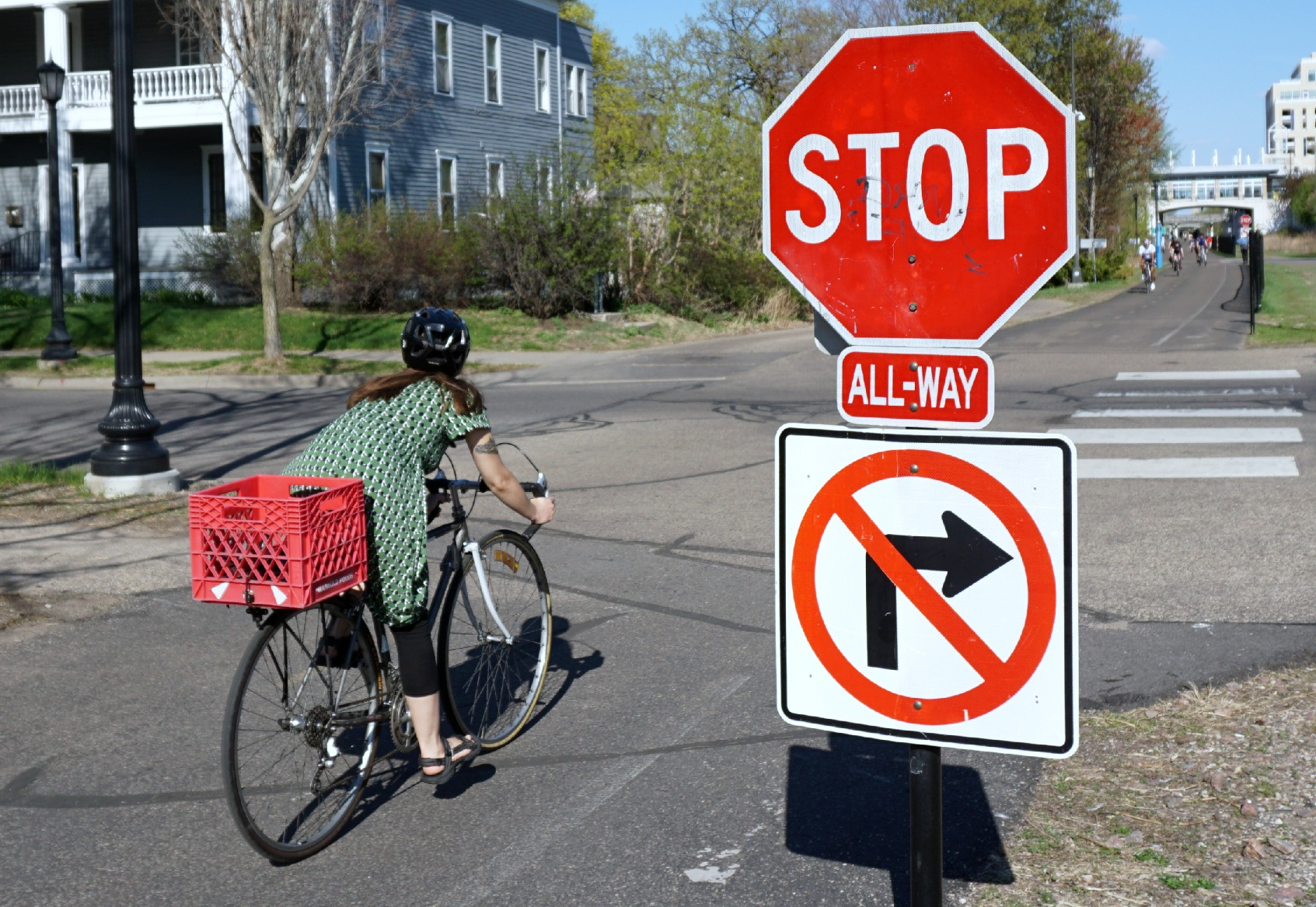 A cyclists pauses briefly at Irving Avenue South before proceeding through the intersection.