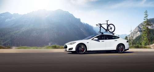 Image of Tesla vehicle with bike on roof rack