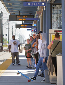 Green Line transit riders waiting at the Snelling station (courtesy of Metro Transit
