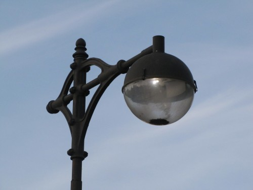 Mercury Vapor lights are extinct from the freeways, but can still be found on the Minneapolis Parkways. This is a standard mercury lamp, color enhanced have a red phosphor giving them a pinkish hue.