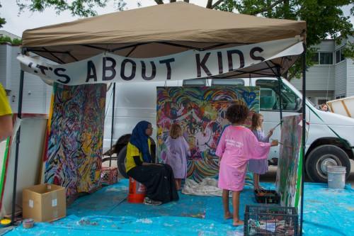 Children lend their hand to a local artwork. / Credit: James Warden