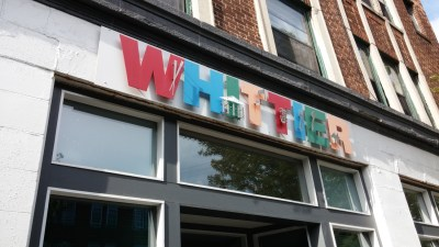 """sign on building that says """"whittier"""""""