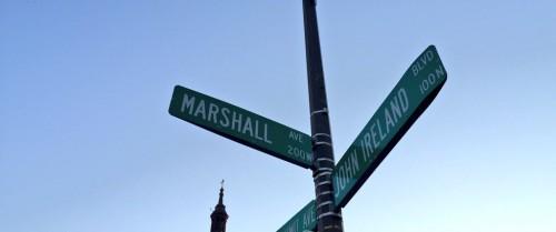 Street sign for Marshall Avenue and John Ireland Blvd
