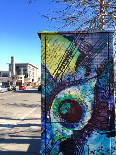 A utility box wrapped in artwork