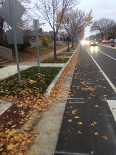 """Looking west, on the south side of the street, there exists several extra sidewalk panels connecting the sidewalk to the curb. The stairs for the preschool are seen in the far left, in line with the first """"catwalk""""."""