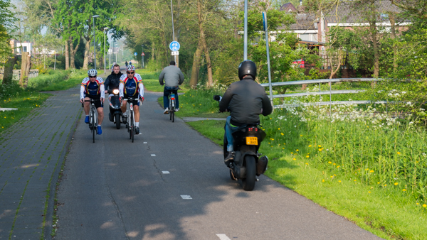 Bikeways should be designed for all users; fast, slow, young, old, and those with disabilities. Netherlands bikeways have become so popular with scooters that there are efforts afoot to ban them.