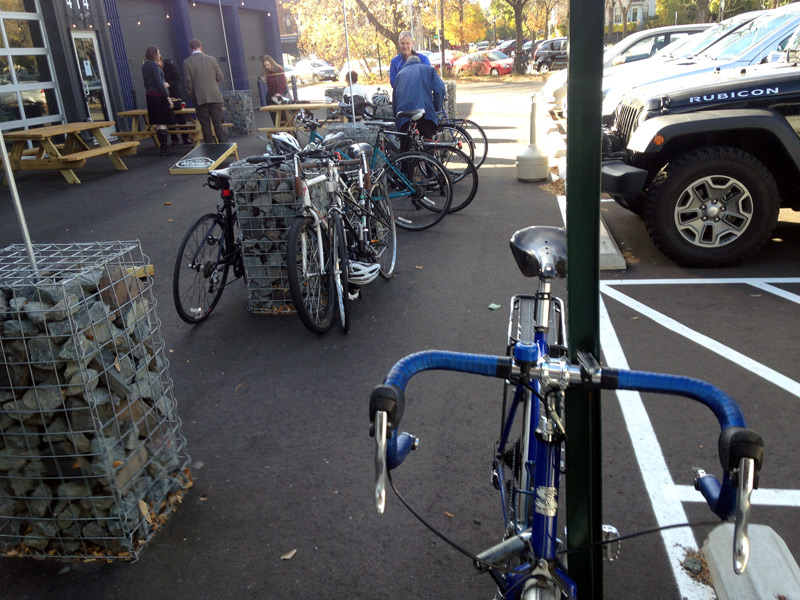 Bicycles parked NOT in the bike rack at Bad Weather brewing. (Rack is around the corner.)