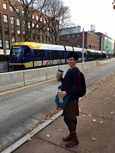 Woman waiting for light rail