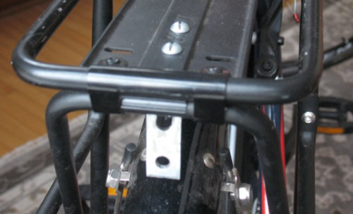 Like many back racks, this one lacked a universal reflector mount so I had to make one from a metal L-bracket