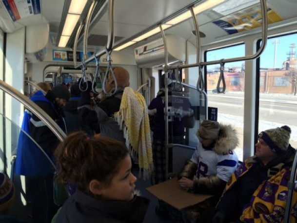 Green Line Train Filling With Fans and Warm Clothes